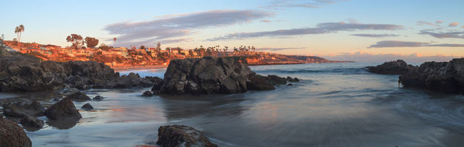 Crescent Bay beach panoramic view of the ocean at sunset in Laguna Beach, California, United States in summer Beach Beauty In Nature California Crescent Bay Day Laguna Beach, CA Landscape Nature No People Ocean Outdoors Panorama Panoramic Panoramic Landscape Panoramic Photography Panoramic View Rock - Object Sand Scenics Sea Sea And Sky Sky Sunset Water