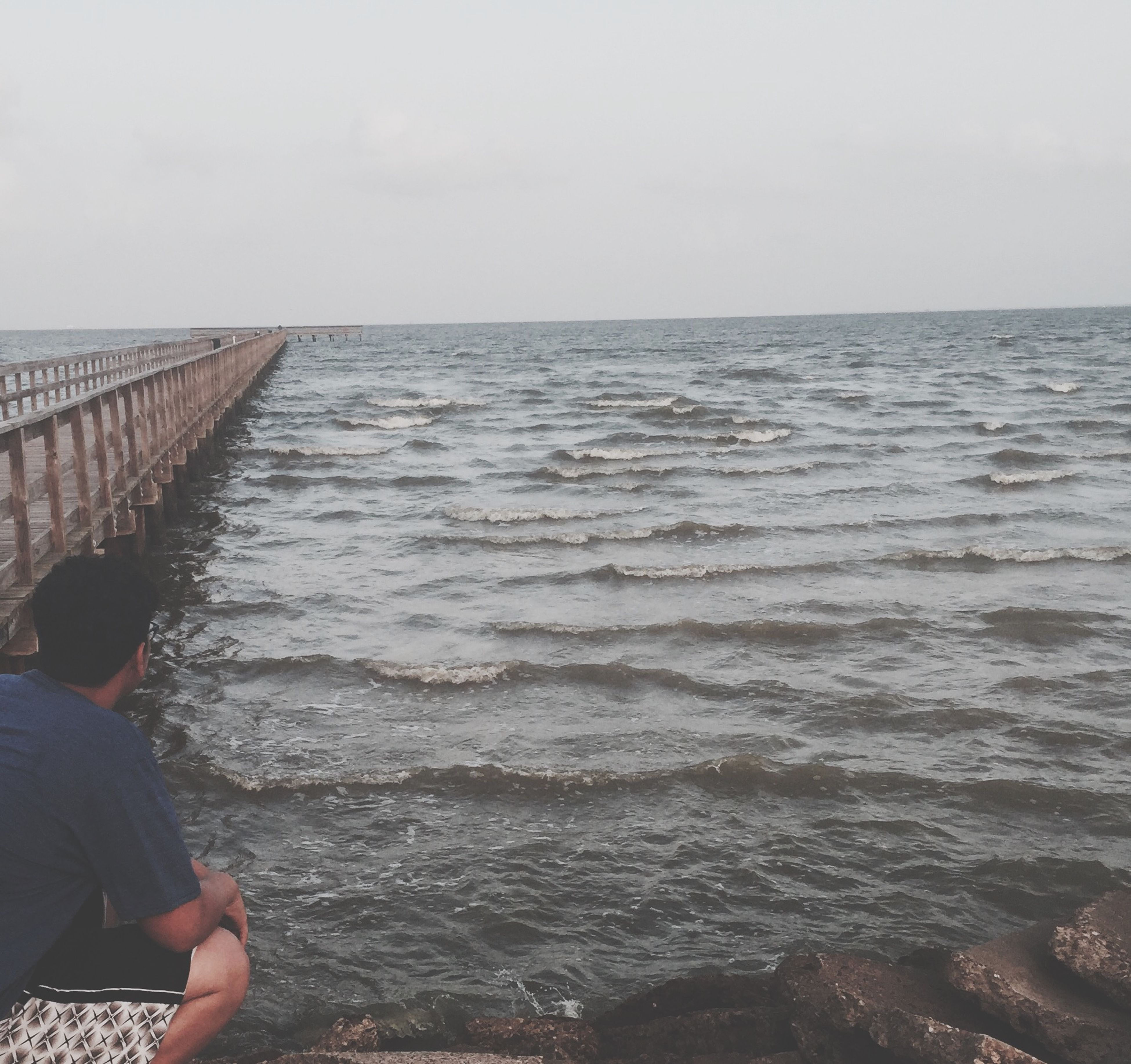 water, sea, lifestyles, leisure activity, men, horizon over water, standing, sky, rear view, person, railing, built structure, pier, nature, day, unrecognizable person, outdoors, scenics