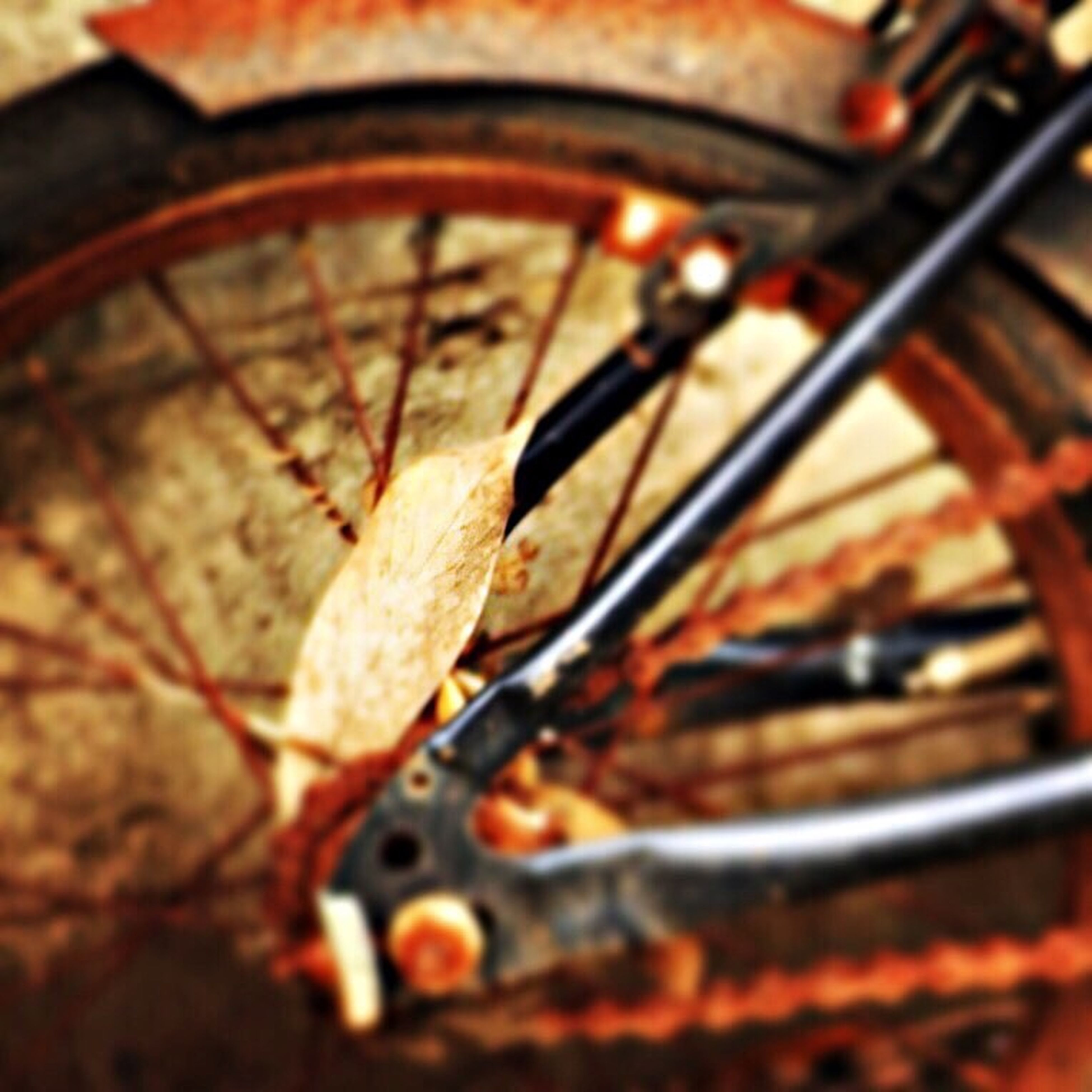 metal, close-up, rusty, indoors, selective focus, obsolete, metallic, old, focus on foreground, damaged, deterioration, abandoned, wheel, no people, still life, high angle view, part of, run-down, day, transportation