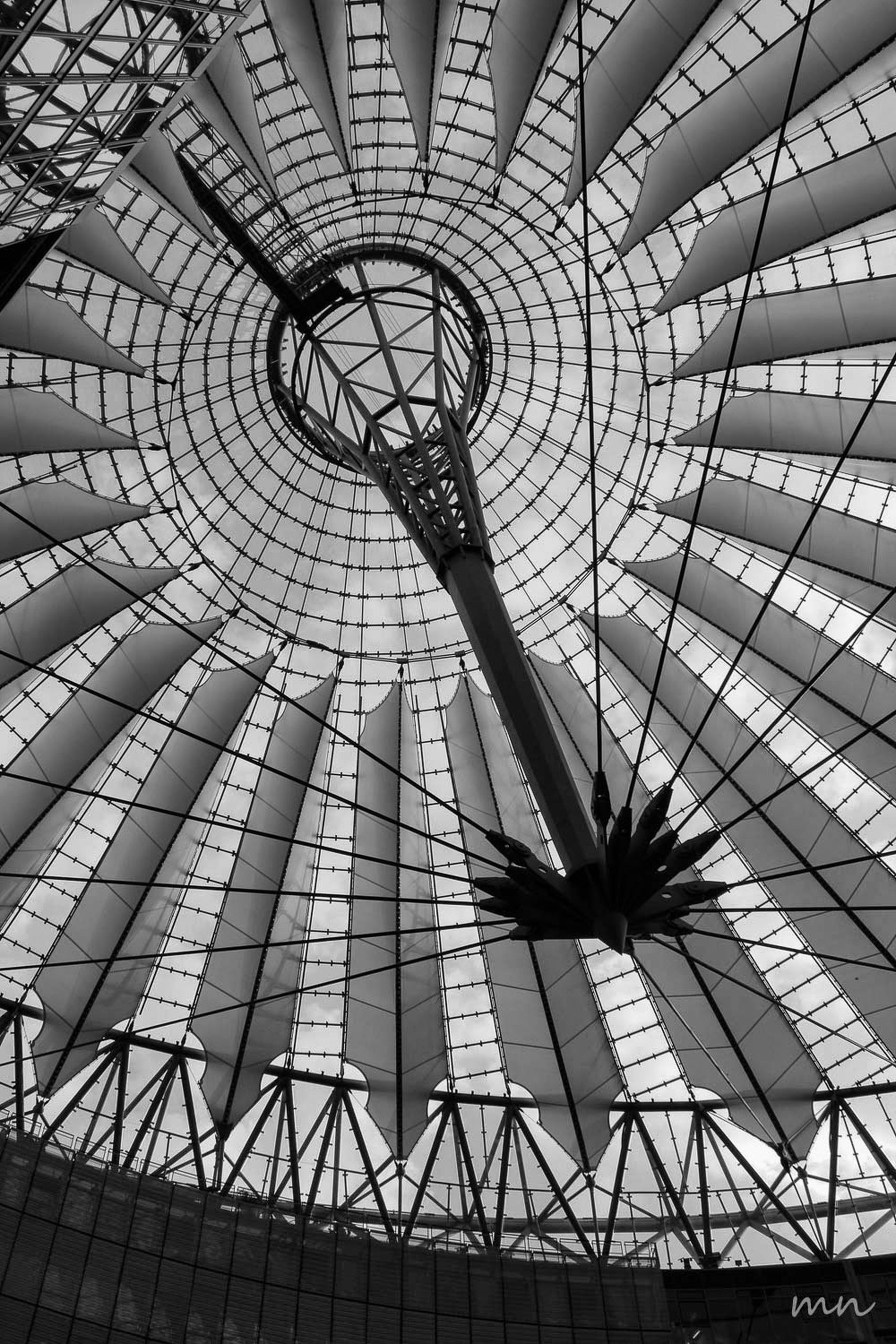 low angle view, built structure, architecture, pattern, ceiling, metal, design, indoors, architectural feature, sky, day, no people, famous place, arts culture and entertainment, travel destinations, directly below, travel, modern, geometric shape