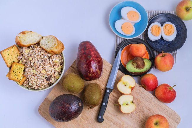 Lots of healthy food Abundance Apple Avocado Baked Boiled Eggs Breakfast Cereal Chopping Board Cracker Food Freshness Friuts Group Of Objects Healthy Eating Healthy Food Kitchenknife Kiwi Fruit Meal Multi Colored No People Plate Ready-to-eat Snack Still Life Variation