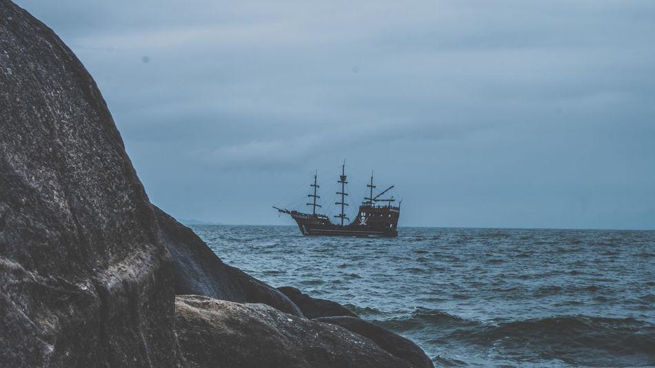 Day Nautical Vessel Outdoors Pirateship  Rocks And Water Sailing Ship Sea Sky Transportation Water