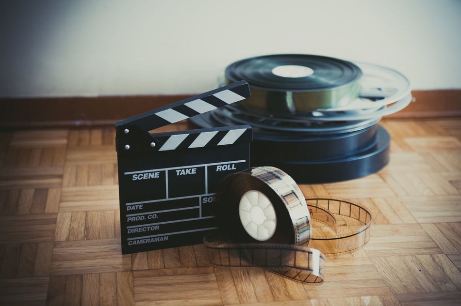 Movie clapper board and reel vintage colors Antique Celluloid Cinema Clapper Board Close-up Film Focus On Foreground MOVIE No People Reel Selective Focus Still Life Vintage
