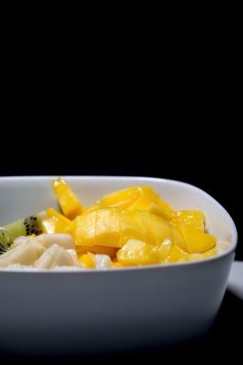 Black Background Bowl Studio Shot Healthy Eating Food And Drink Food Yellow Close-up Freshness No People Ready-to-eat Comfort Food Food And Drink Fruit Fruits Health Healthy Fitness Healthy Food Healthy Lifestyle Lifestyle Mango Fruit Photography Sliced Fruit Food Photography