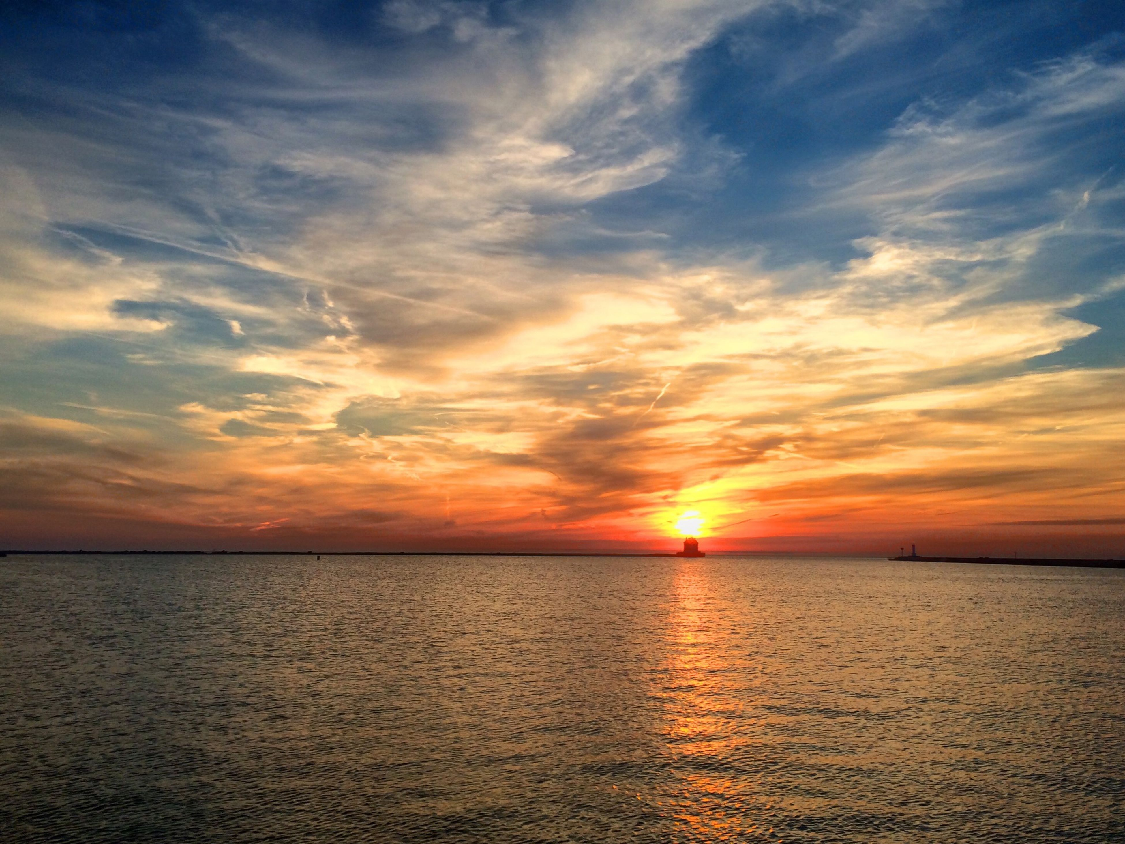 sunset, sea, water, scenics, tranquil scene, waterfront, tranquility, beauty in nature, sky, horizon over water, orange color, sun, idyllic, nature, cloud - sky, reflection, cloud, rippled, sunlight, dramatic sky