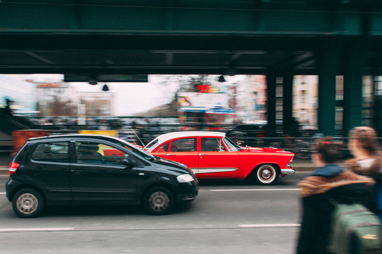 Red racer. Architecture Berlin Berliner Ansichten Blurred Motion Building Exterior Built Structure Car City Day Land Vehicle Men Mode Of Transport Motion Movement Oldtimer One Person Outdoors People Prenzlauerberg Real People Red Road Speed Streetphotography Transportation