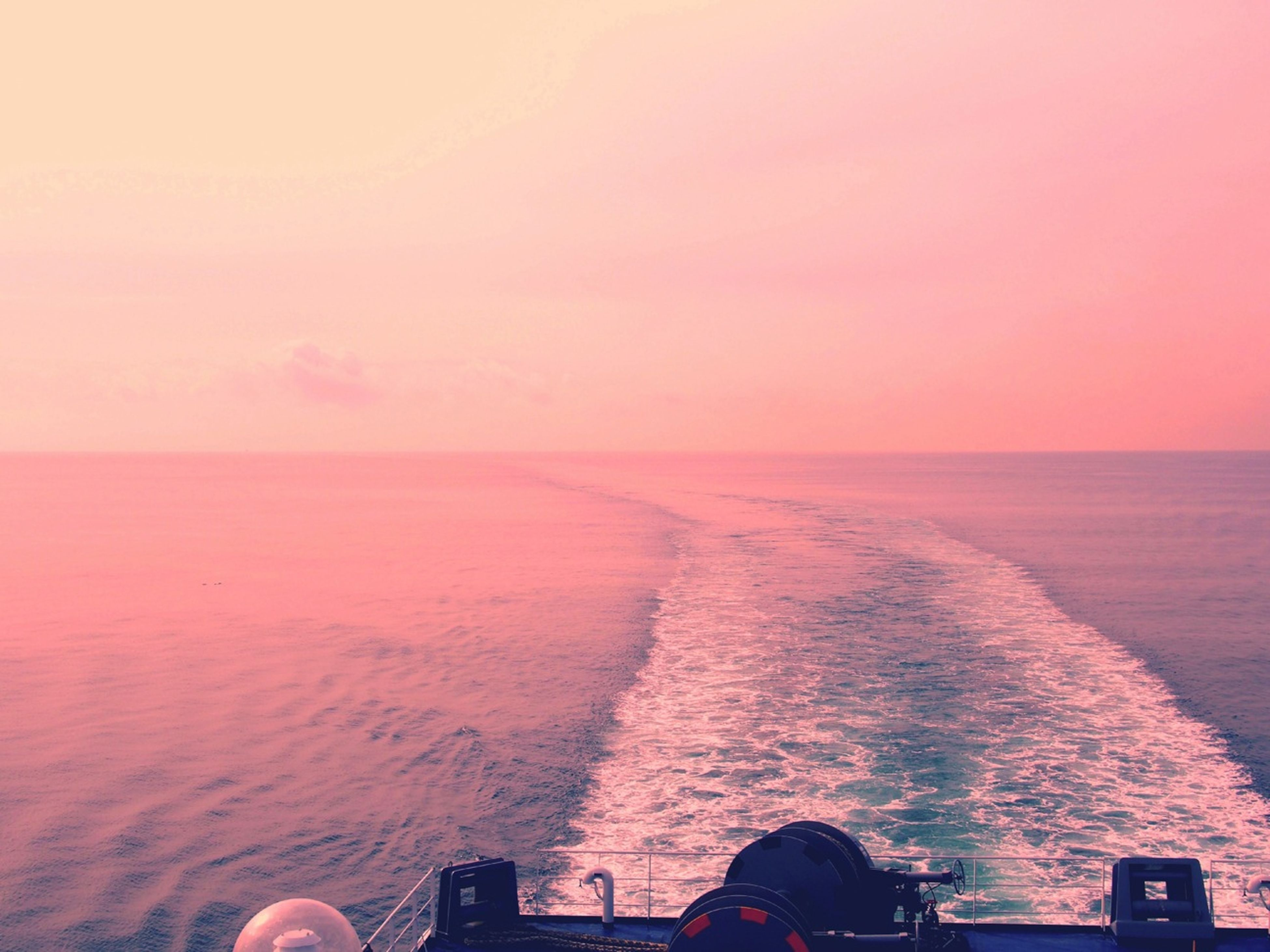 sea, horizon over water, sunset, water, transportation, mode of transport, sky, scenics, beauty in nature, copy space, nature, tranquil scene, leisure activity, lifestyles, men, nautical vessel, part of, tranquility