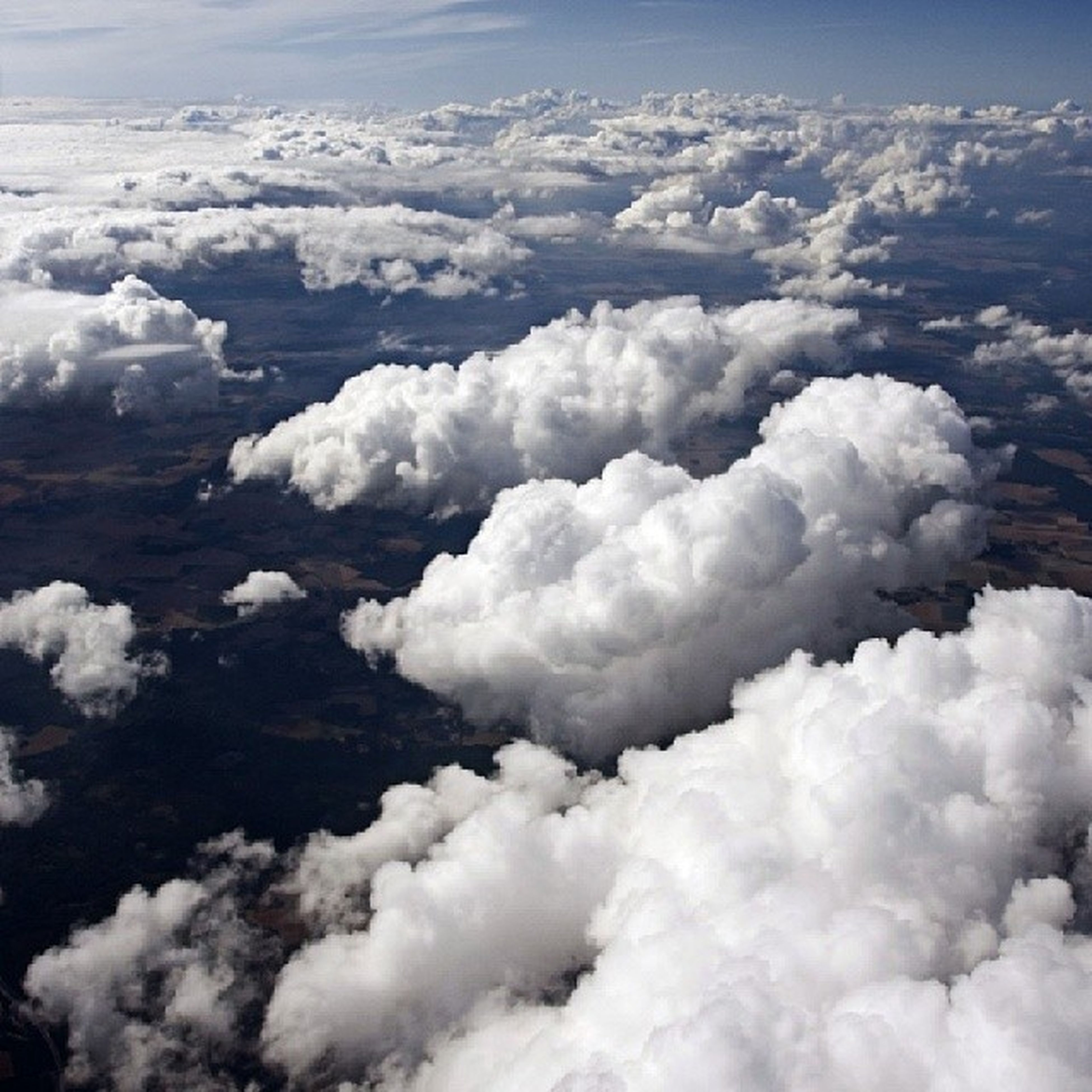 beauty in nature, white color, cloudscape, scenics, nature, sky, backgrounds, sky only, tranquility, tranquil scene, cloud - sky, aerial view, full frame, white, softness, weather, fluffy, cloudy, idyllic, cloud