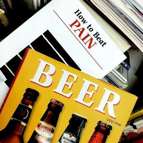 How to beat pain? Pain Hanging Out Cover Book Fair Hurts Best Medicine Alcohol Beer