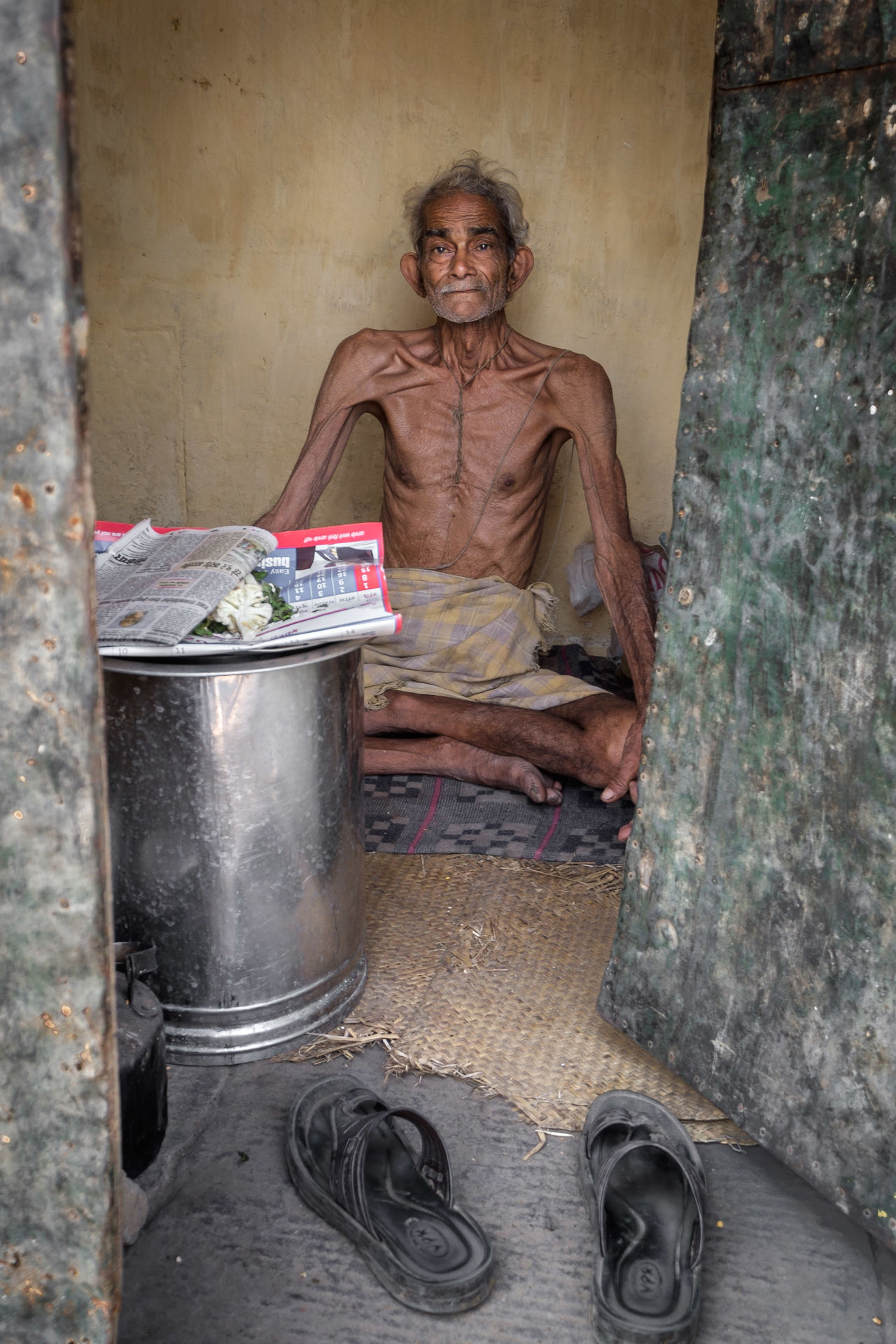 Varanasi is a holy city and is regarded as the last stop before Nirvana. People go there to die, believing that dying in this holy place will release them from the cycle of rebirth. This gentleman has no family to care for him - he just sits and waits. Documentary Photography Malnutrition Old Man Photojournalist - 2016 EyeEm Awards Poverty Travel Photography Varanasi India
