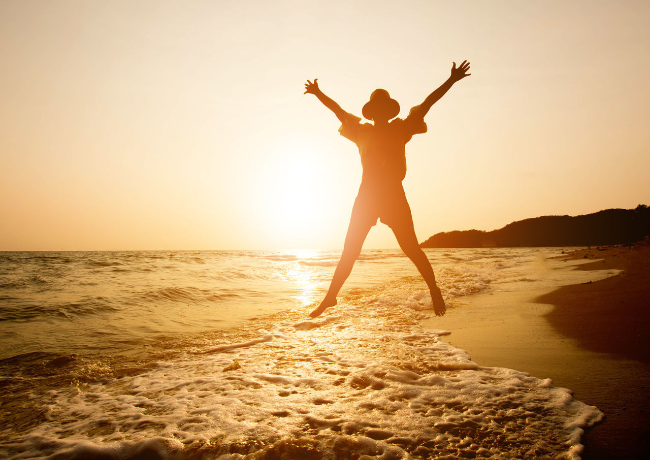 Adult Adults Only Back Lit Beach Cheerful Coastline Freedom Full Length Happiness Healthy Lifestyle Horizon Over Water Human Body Part Joy Lifestyles Motion Nature One Woman Only Only Women Outdoors People Sea Sunlight Sunset Water Women