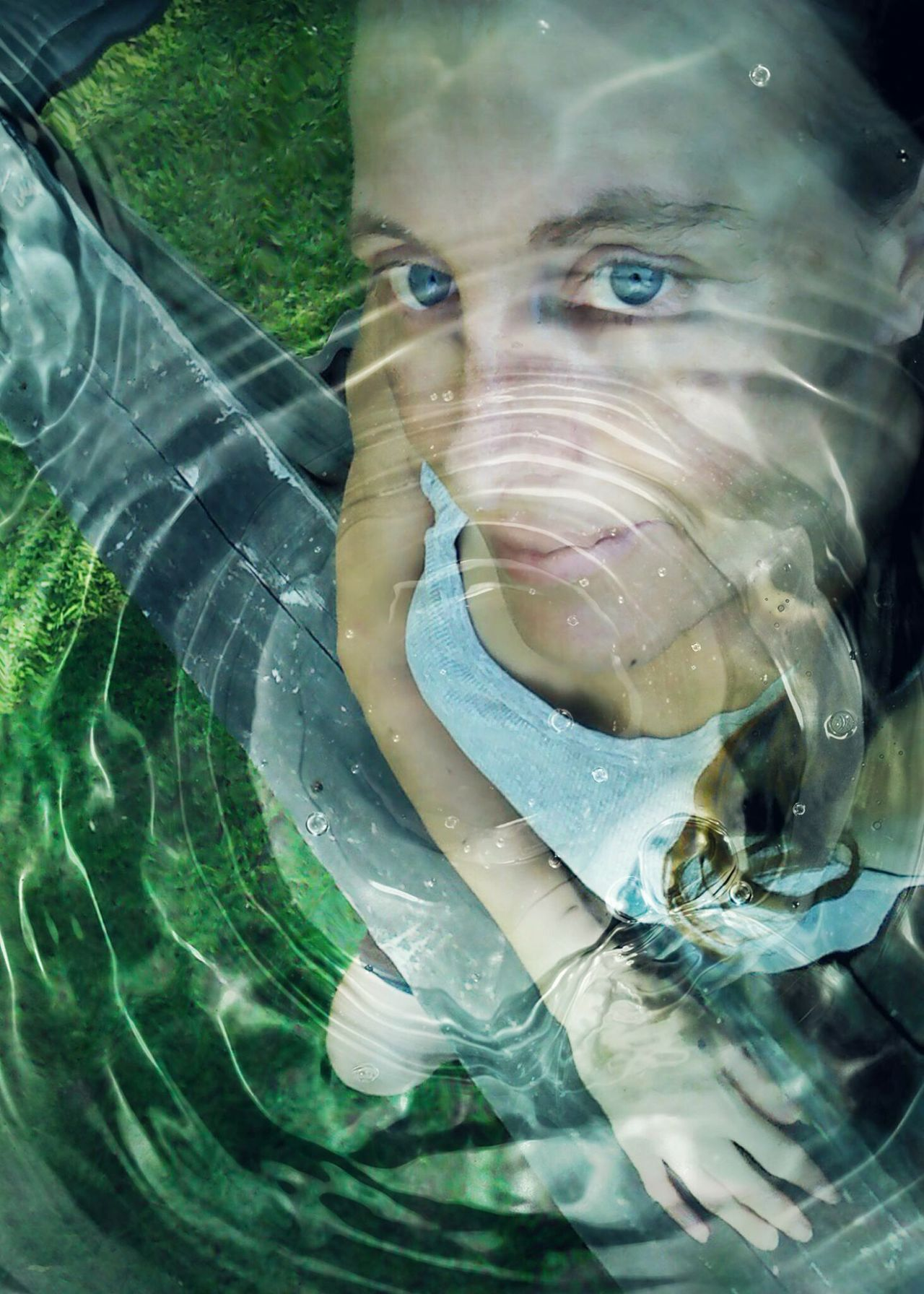 Water Rings Water Surface Self Portrait No Make-up Fragility Close-up Portrait Of A Woman Creative Edit My Art, My Soul... Reflection Tranquility Awakening Woman Here Belongs To Me Water Blue Eyes EyeEm Best Edits