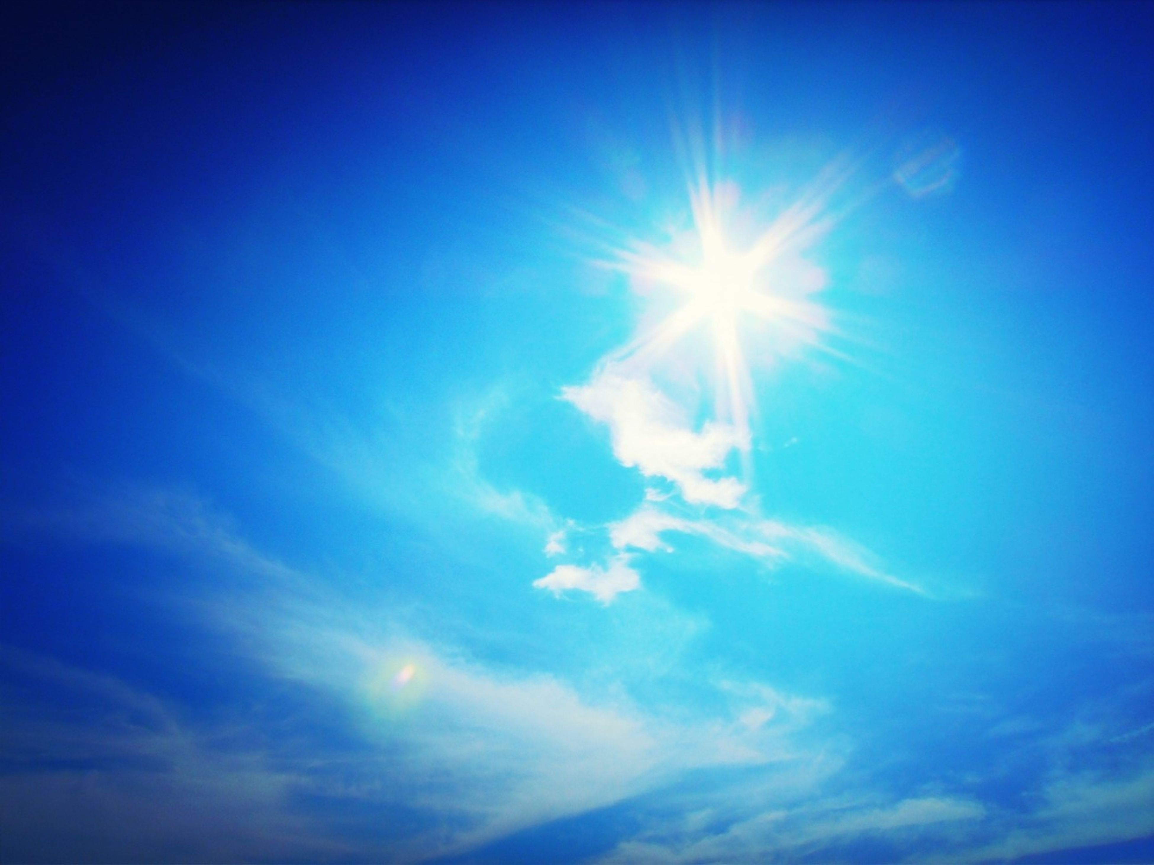 sun, blue, sunbeam, sunlight, low angle view, lens flare, sky, bright, beauty in nature, sunny, tranquility, nature, scenics, tranquil scene, cloud - sky, day, sky only, idyllic, outdoors, cloud
