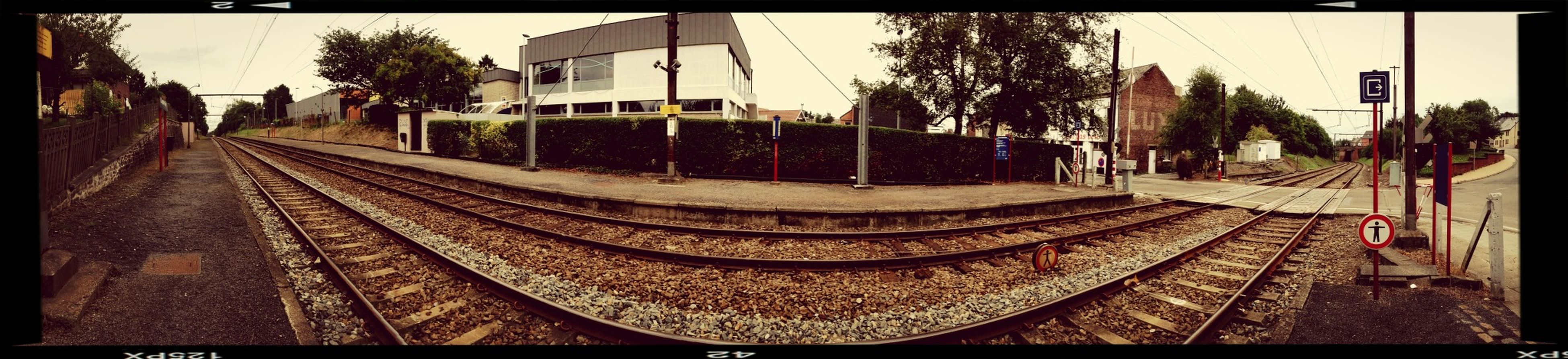 transfer print, transportation, building exterior, auto post production filter, the way forward, architecture, built structure, diminishing perspective, railroad track, tree, city, sky, vanishing point, street, road, incidental people, day, outdoors, panoramic, sunlight