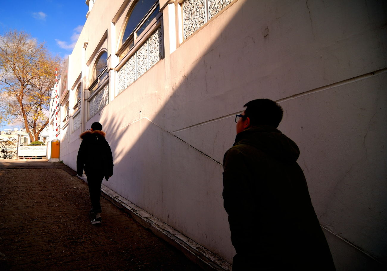 Building Exterior City City Life Dark And Light Day Iteawon Leisure Activity Light And Shadow Outdoors People Rear View Sky The Way Forward Walking