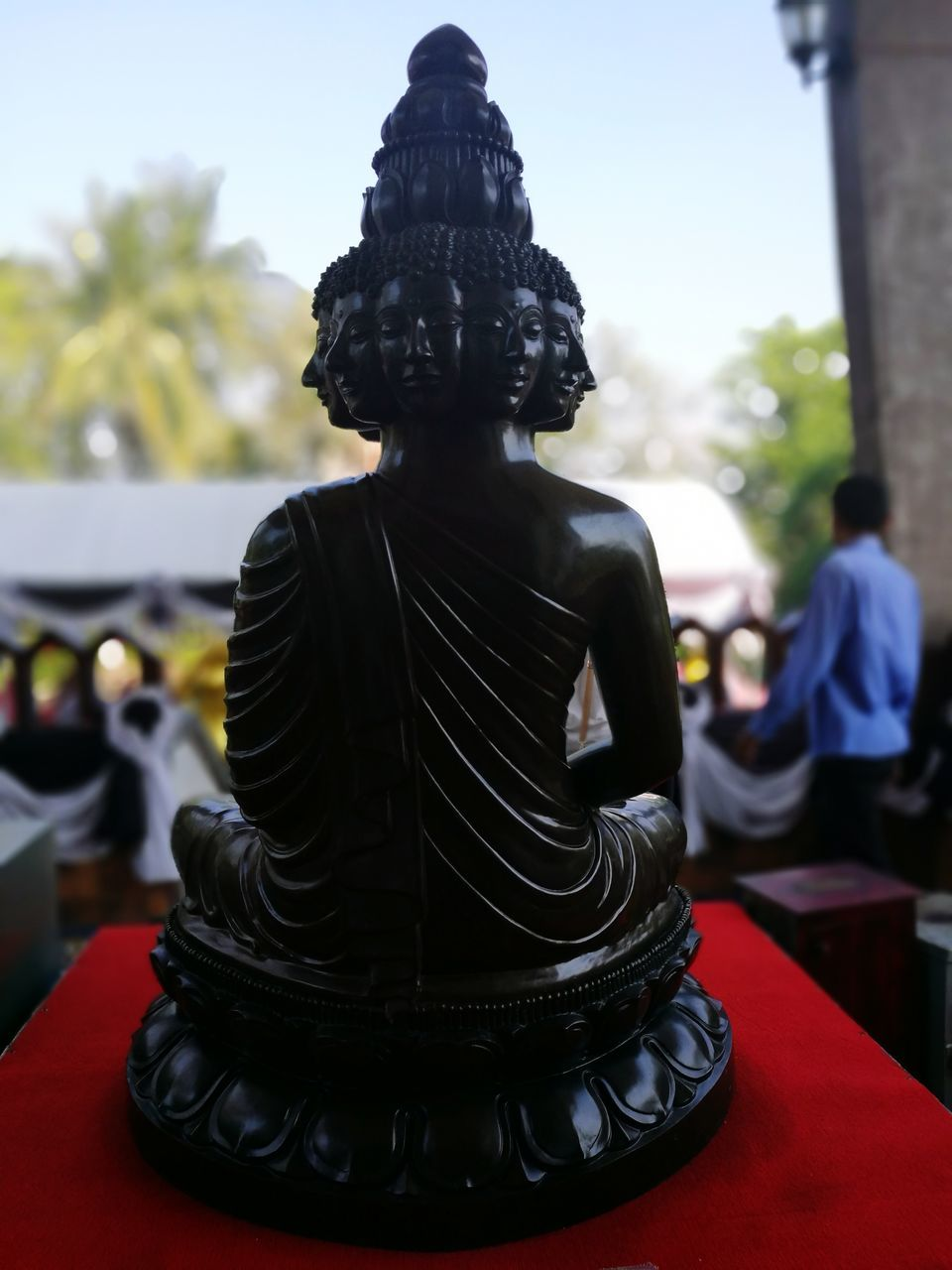 statue, sculpture, human representation, religion, spirituality, male likeness, focus on foreground, idol, place of worship, day, no people, outdoors, close-up