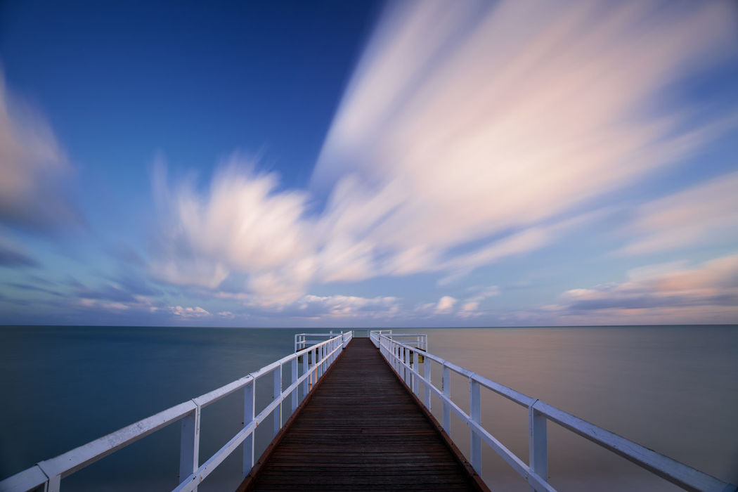 Beach Beauty In Nature Blue Bridge - Man Made Structure Clear Sky Day Footbridge Hervey Bay Horizon Over Water Jetty Landscape Moving Coo Nature No People Outdoors Pier Railing Romantic Sky Scenics Sea Sky Travel Destinations Water