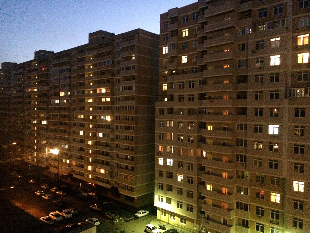 architecture, building exterior, city, window, built structure, apartment, skyscraper, urban, illuminated, residential building, night, residential, no people, outdoors, cityscape