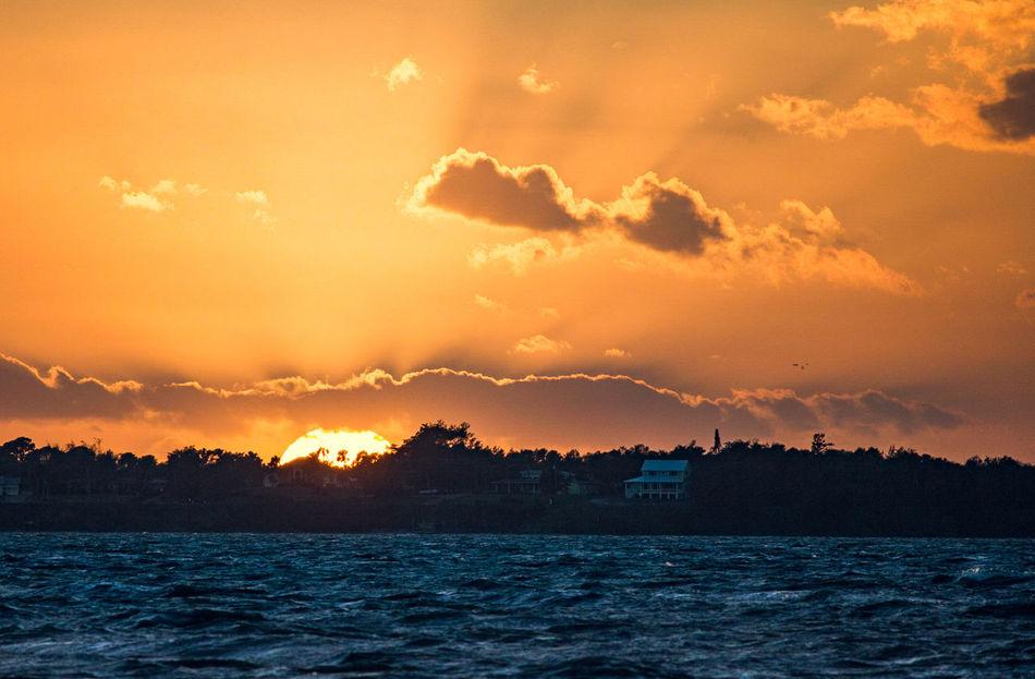 Sunset Outdoors Sky No People Beach Nature Tranquility Horizon Sea Sun Landscape Sunlight Dramatic Sky Beauty In Nature Orange Color Horizon Over Water Florida Sea Land Sky Cloud - Sky Adventure Travel
