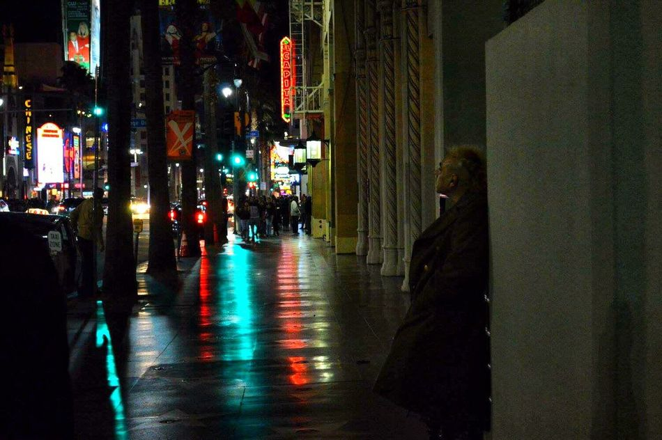 Urban Outdoors Night Illuminated Real People One Person Streetphotography Hollywood Hall Of Fame