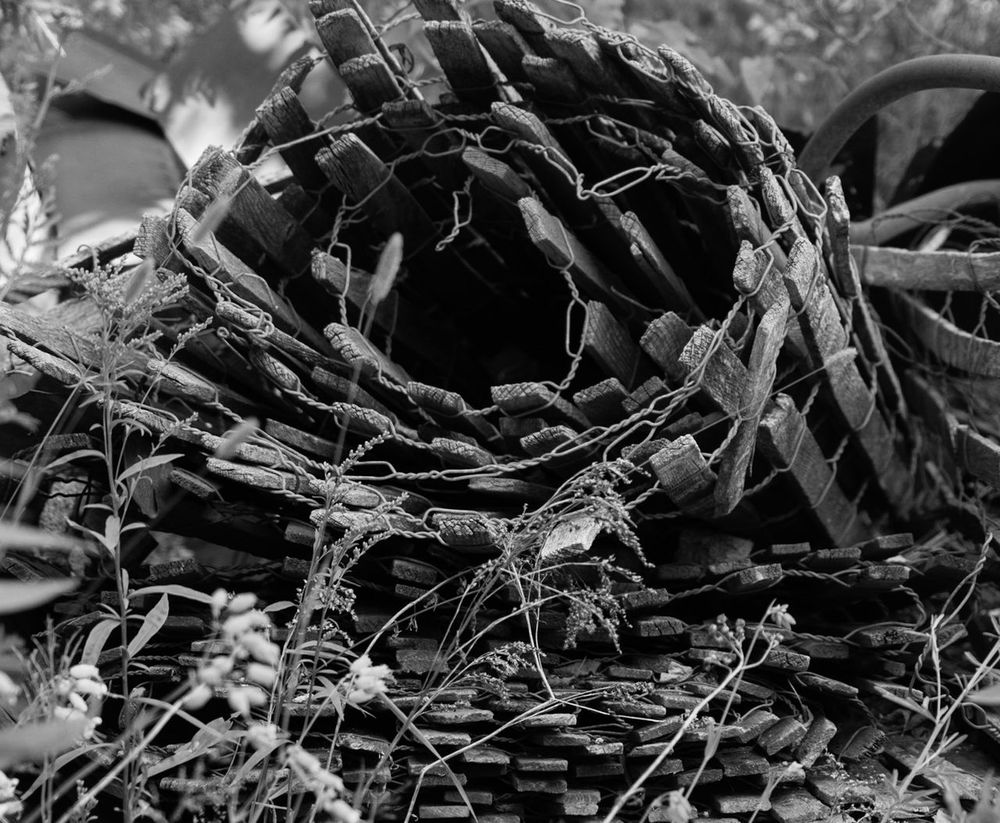 Black And White Friday Fishing Net No People Outdoors Day Fishing Tackle Close-up Nature Spiral Design Rubble Weathered Textured  Urban Decay Low Angle View Building Exterior Eyeemphoto Fencing Fence Pattern