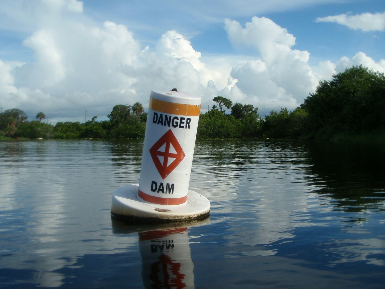 Danger Dam Danger Sign Water Dam Water Reservoir No People Water Reflections Still Water Calm Waters Water Environment Lake Nature Outdoors Communication Warning Sign Calm Water Reflection Buoy