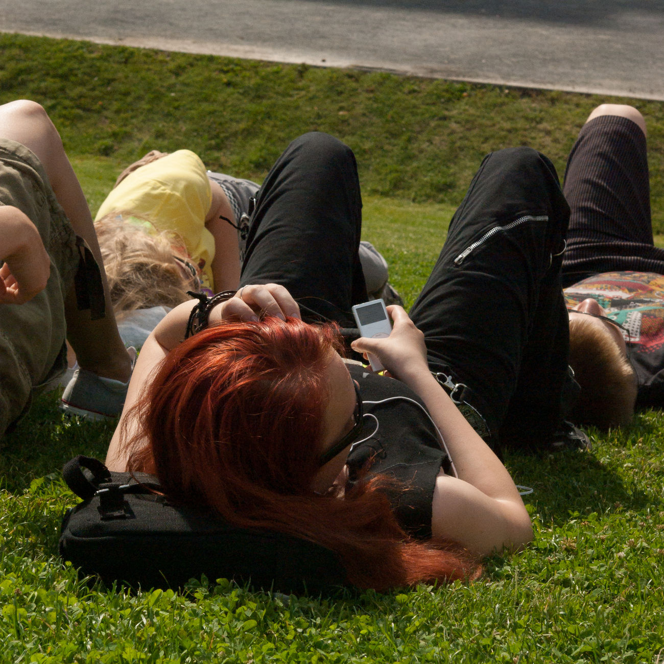 2008 Cultures Day Grass Horizontal Lifestyles Lying Down Outdoors People Person Red Hair Tourist Destination Tourists Unrecognizable People Young Adult