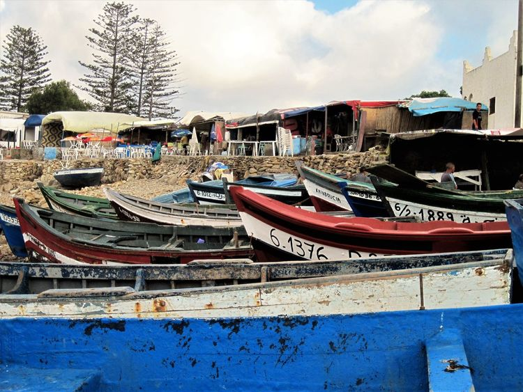 Architecture Day Fishing Village Mode Of Transport Multi Colored Nautical Vessel No People Outdoors Restaurants Sky Stranded Transportation Travel Travel Destinations Tree