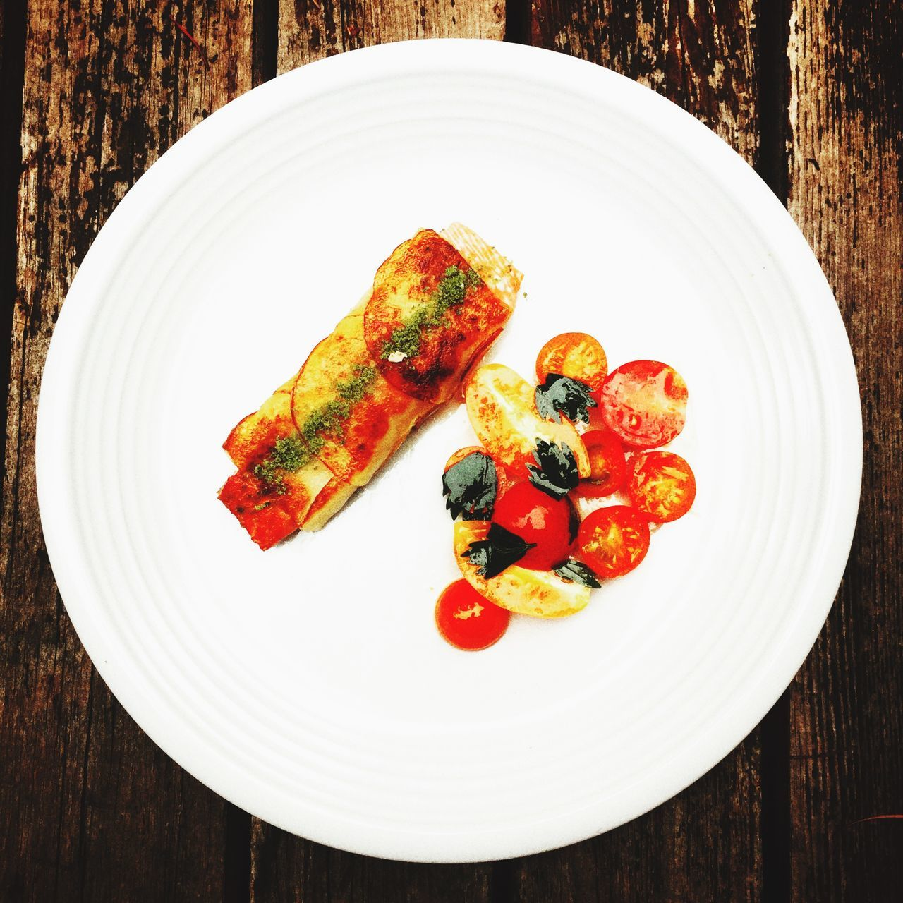 High Angle View Of Crusted Salmon With Tomatoes In Plate