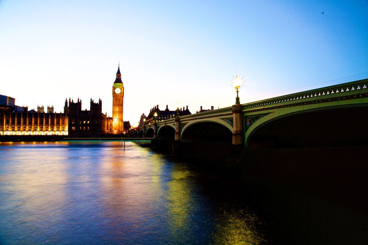 Architecture Bridge - Man Made Structure Building Exterior Built Structure City Clock Tower Cultures Government Houses Of Parliament On The River Thames Houses Of Parliment Big Ben City Of Westminster Red Buses Sunshine Blue Sky Trees Brances Could Blue Sky Illuminated No People Outdoors Politics And Government Sky Travel Destinations Urban Skyline