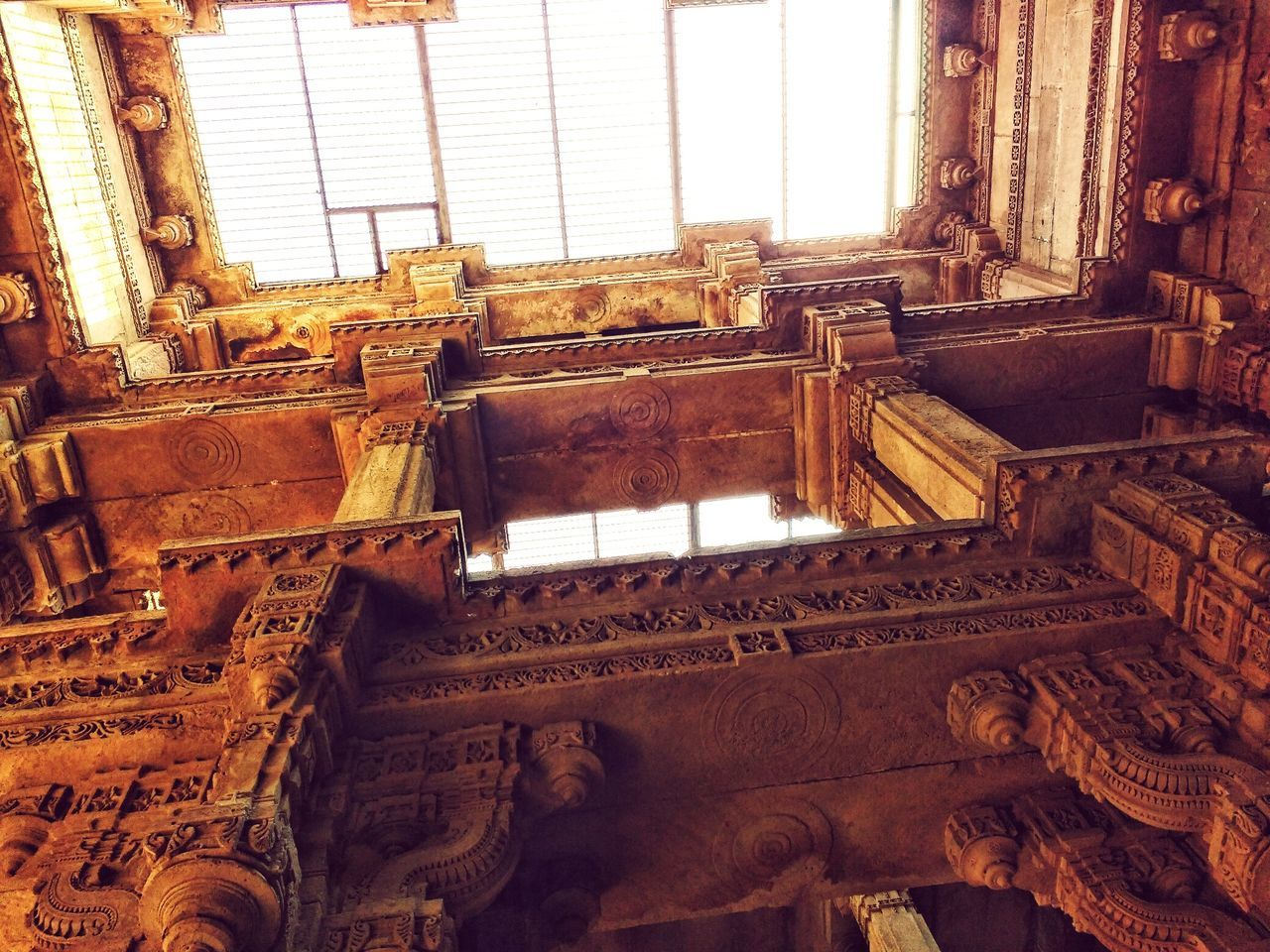 history, architecture, old, built structure, window, indoors, the past, low angle view, day, no people, ancient, sculpture, statue, old ruin, travel destinations, architectural column, ancient civilization