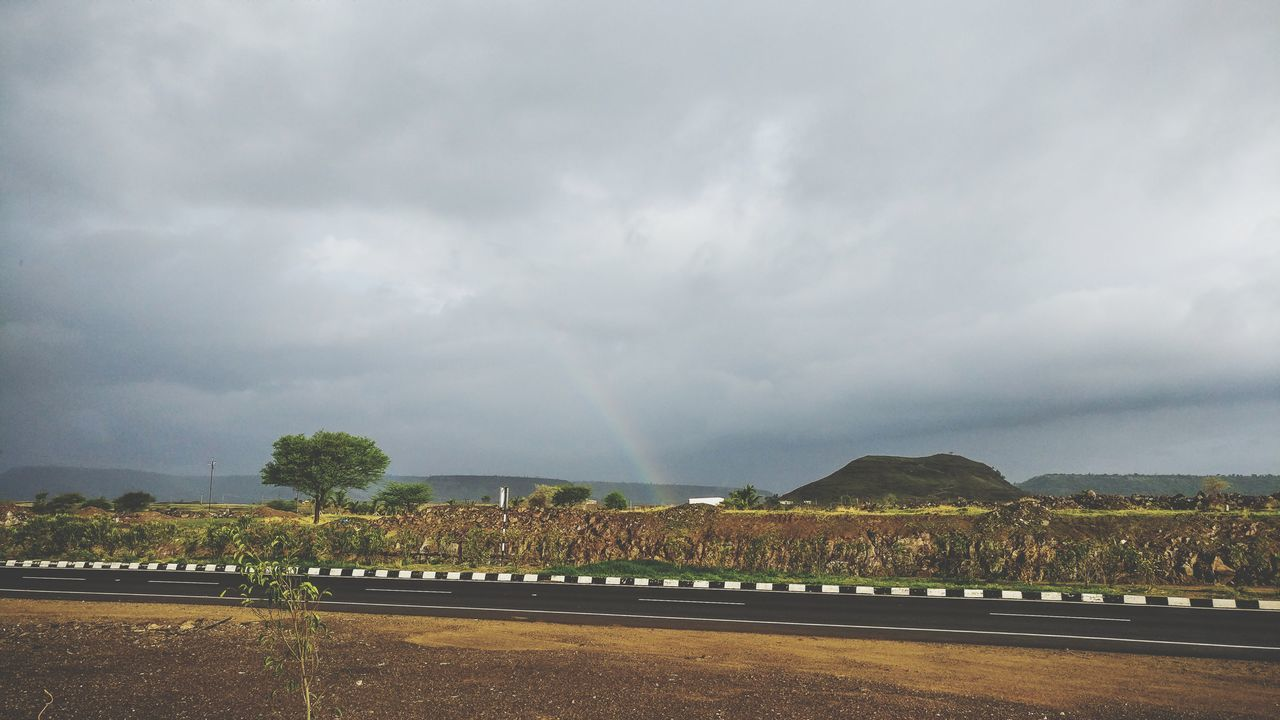 Rainbow On Nashik - Pune Expressway Storm Cloud Dramatic Sky Thunderstorm Freshness Sky Outdoors Landscape Nature Beauty In Nature Scenics Cloud - Sky Rainbow Rainy Days Rainbow🌈 Agriculture Highway Expressway First Eyeem Photo