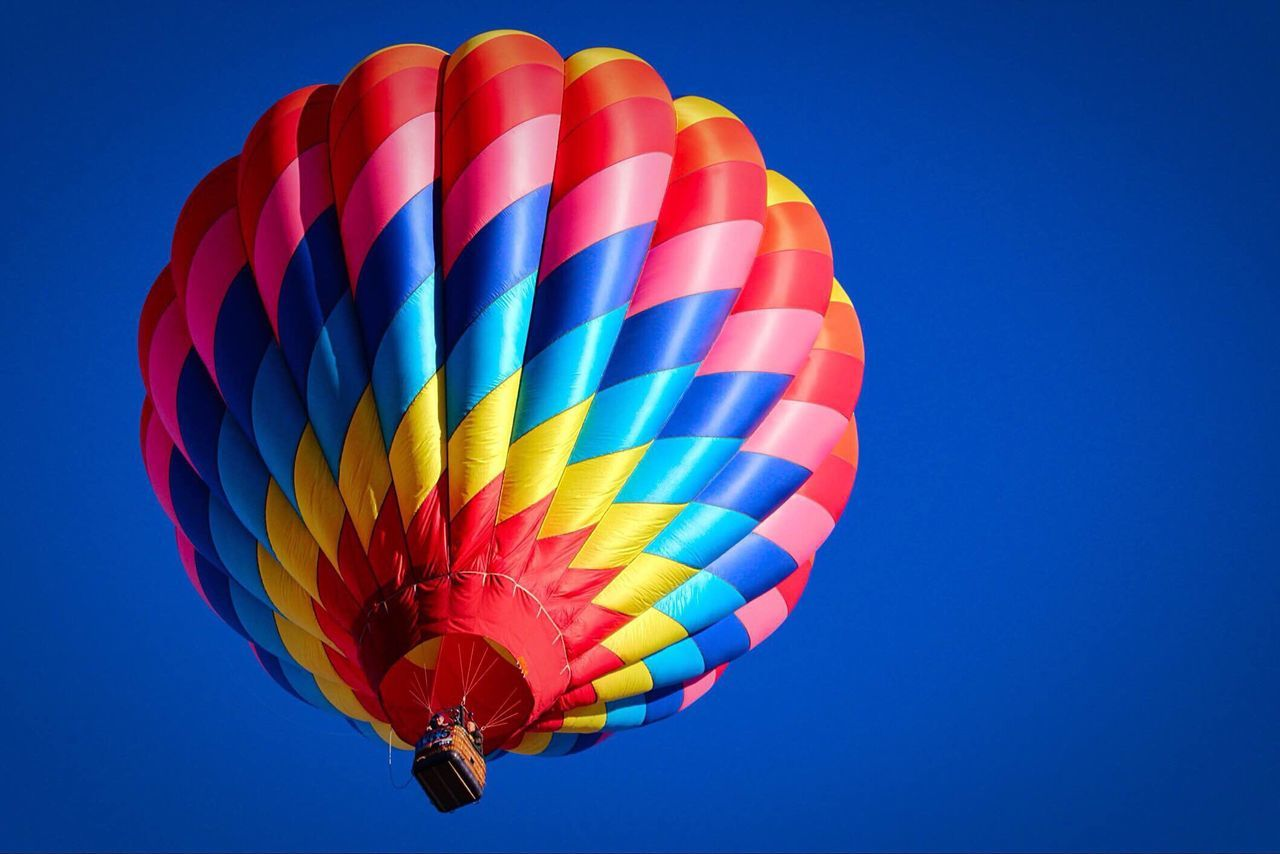 Hot Air Balloon Adventure Multi Colored Basket Transportation Flying Clear Sky Low Angle View Ballooning Festival Blue Mid-air Outdoors Sky Air Vehicle Day Parachute One Person Close-up People Oregon Central Oregon PNW Colorful Daytime Summertime