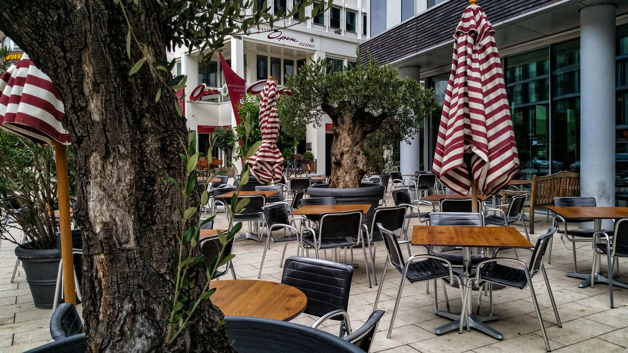 before the opera Architecture Arrangement Before The Opera Building Exterior Built Structure Chair City City Life Day Hamburg Handy Photo House In Front Of Morning No People Outdoors Parasols Pole Residential Structure Table Tourist Resort Tree
