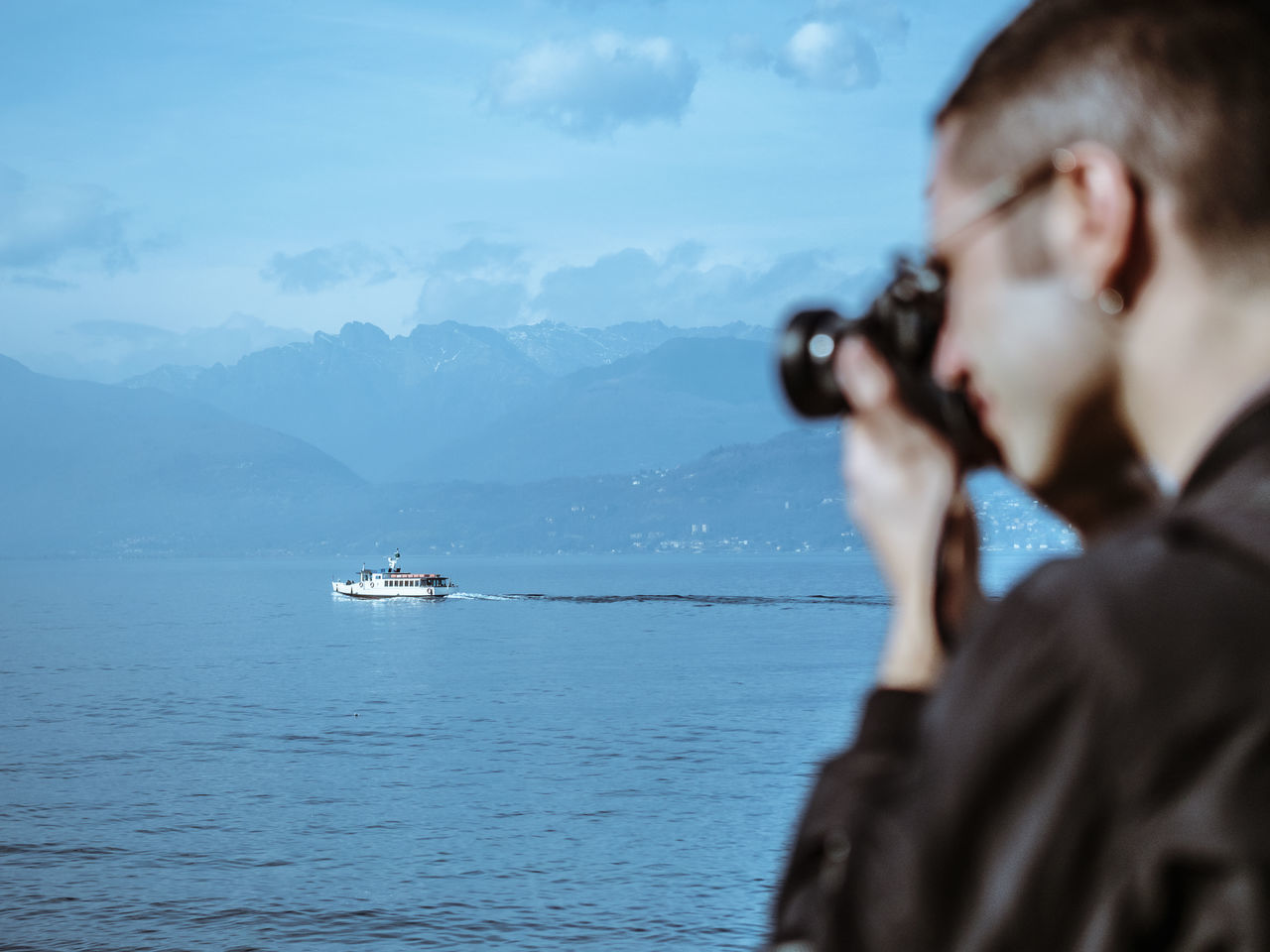 Beauty In Nature Boat Camera Camera - Photographic Equipment Close-up Cloud - Sky Clouds And Sky Hand Hands Lake Landscape Men Nature Nature Photography One Person Sky Sky And Clouds Stresa Water Young Adult Young Men