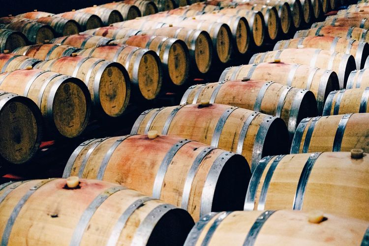 Wine Cellar Massimiliano Tuveri Winery Close-up Old Wine Cask Large Group Of Objects In A Row Abundance Aging Process Repetition Winemaking Autumn Eyeemphoto Tranquility No People Stack Red Selective Focus Colors And Patterns