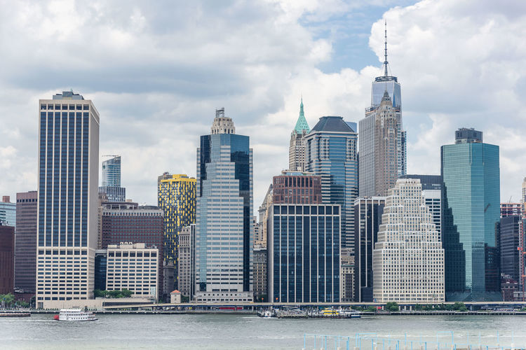 Manhattan New York City USA Architecture Building Exterior Built Structure City Cityscape Cloud - Sky Downtown District Financial District  Growth Modern No People Outdoors River Sky Skyscraper Tall Tall - High Tower Travel Destinations Urban Skyline Water Waterfront