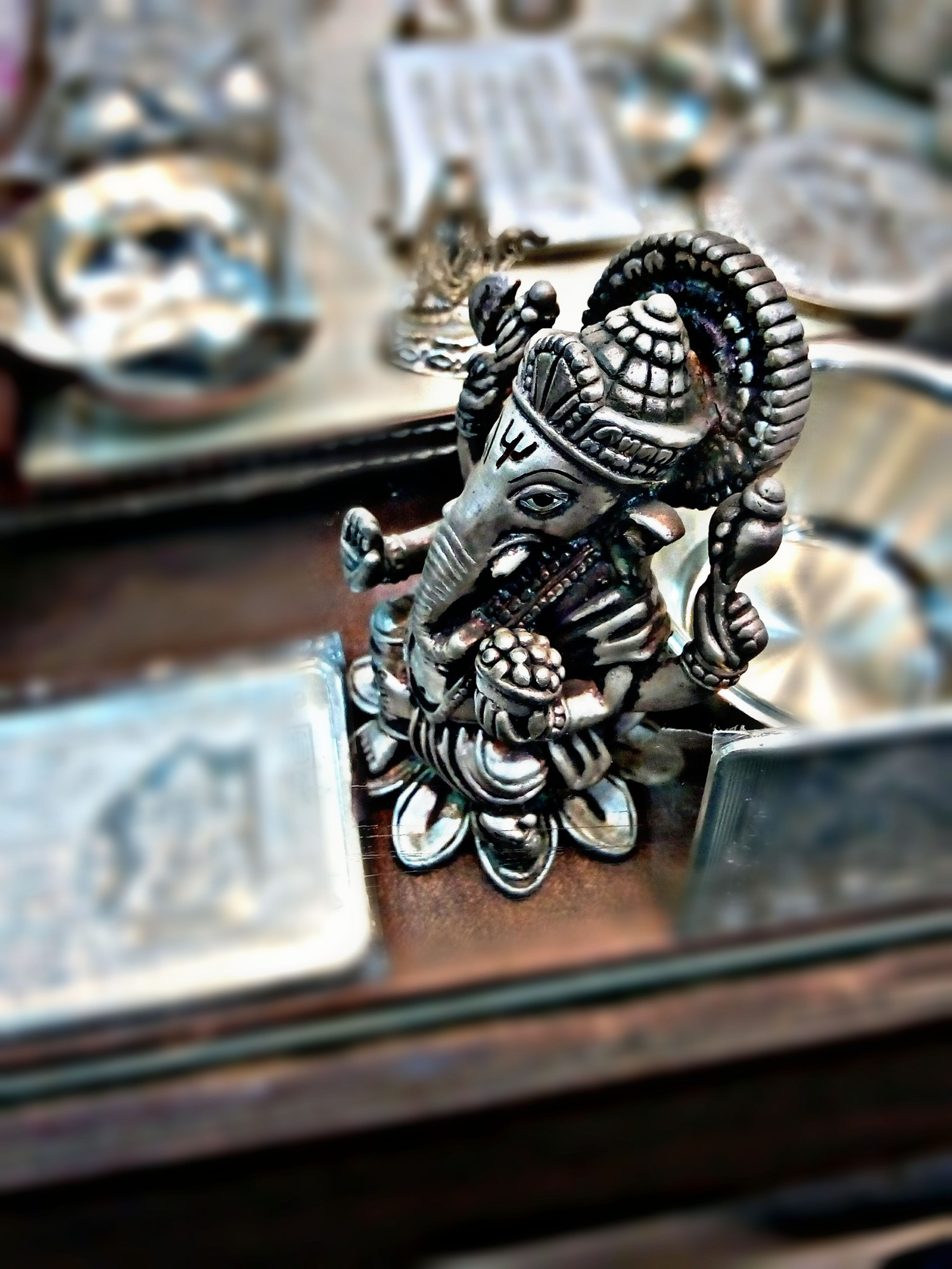 art and craft, art, focus on foreground, indoors, human representation, creativity, close-up, selective focus, animal representation, carving - craft product, sculpture, statue, religion, craft, wood - material, ornate, no people, spirituality, metal