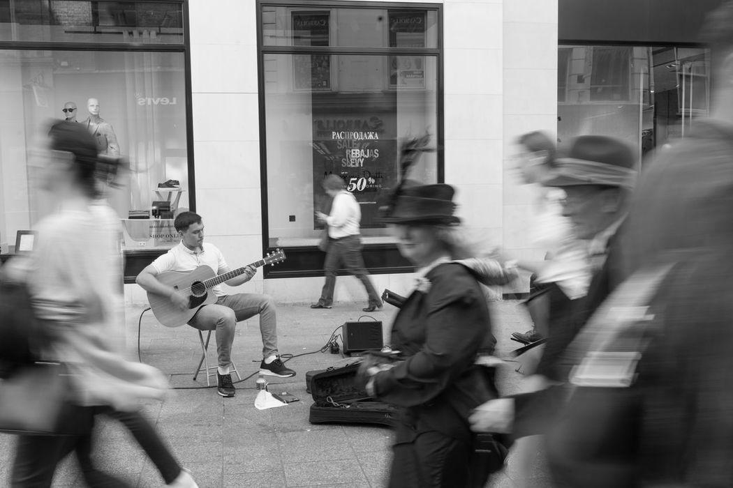 Blurred Motion Walking City Life Crowd Guitarist Dublin Ilovedublin Igersdublin Black And White Photography Black And White Bw