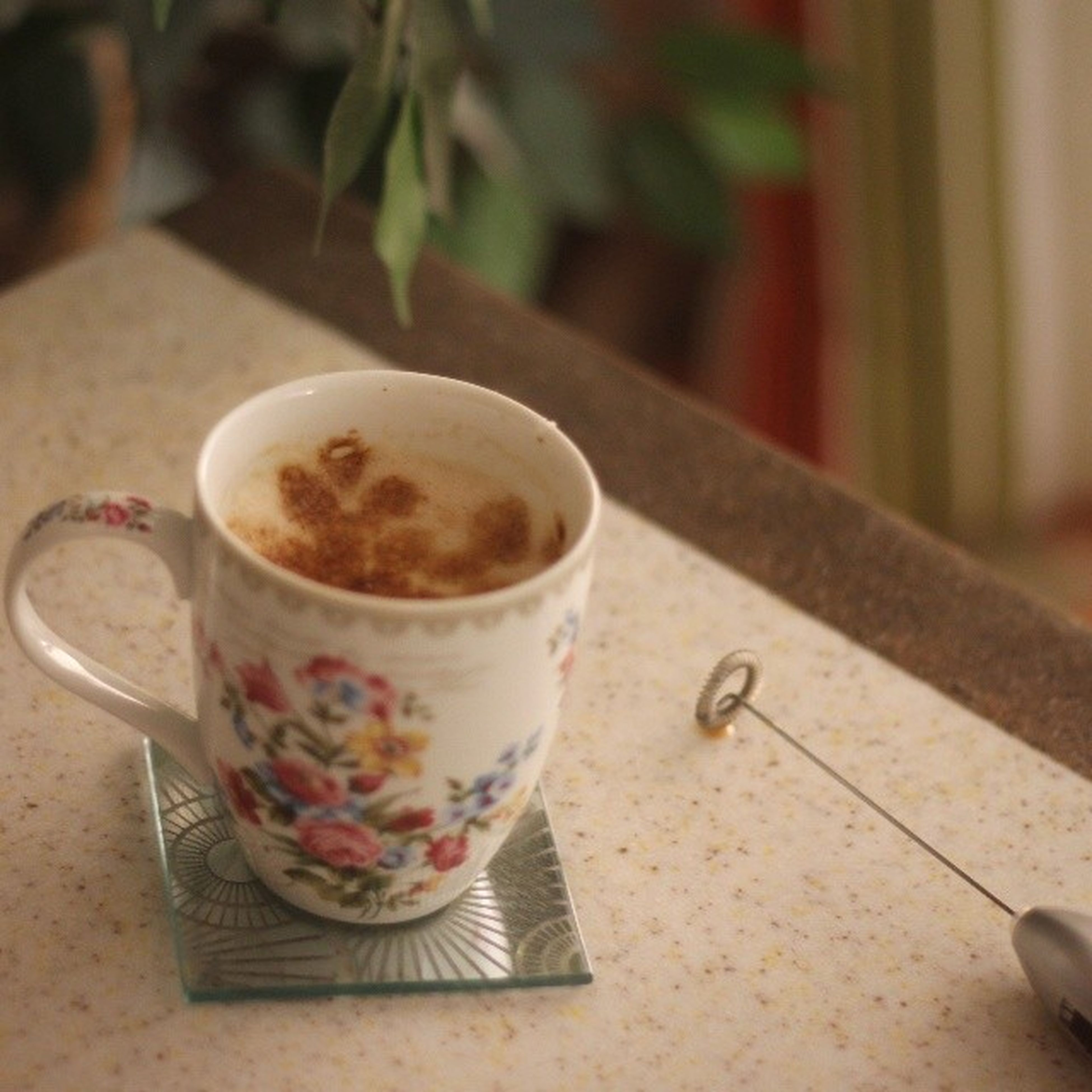food and drink, coffee cup, drink, coffee - drink, table, refreshment, indoors, freshness, saucer, still life, close-up, frothy drink, coffee, focus on foreground, spoon, cup, cappuccino, selective focus, beverage, froth art