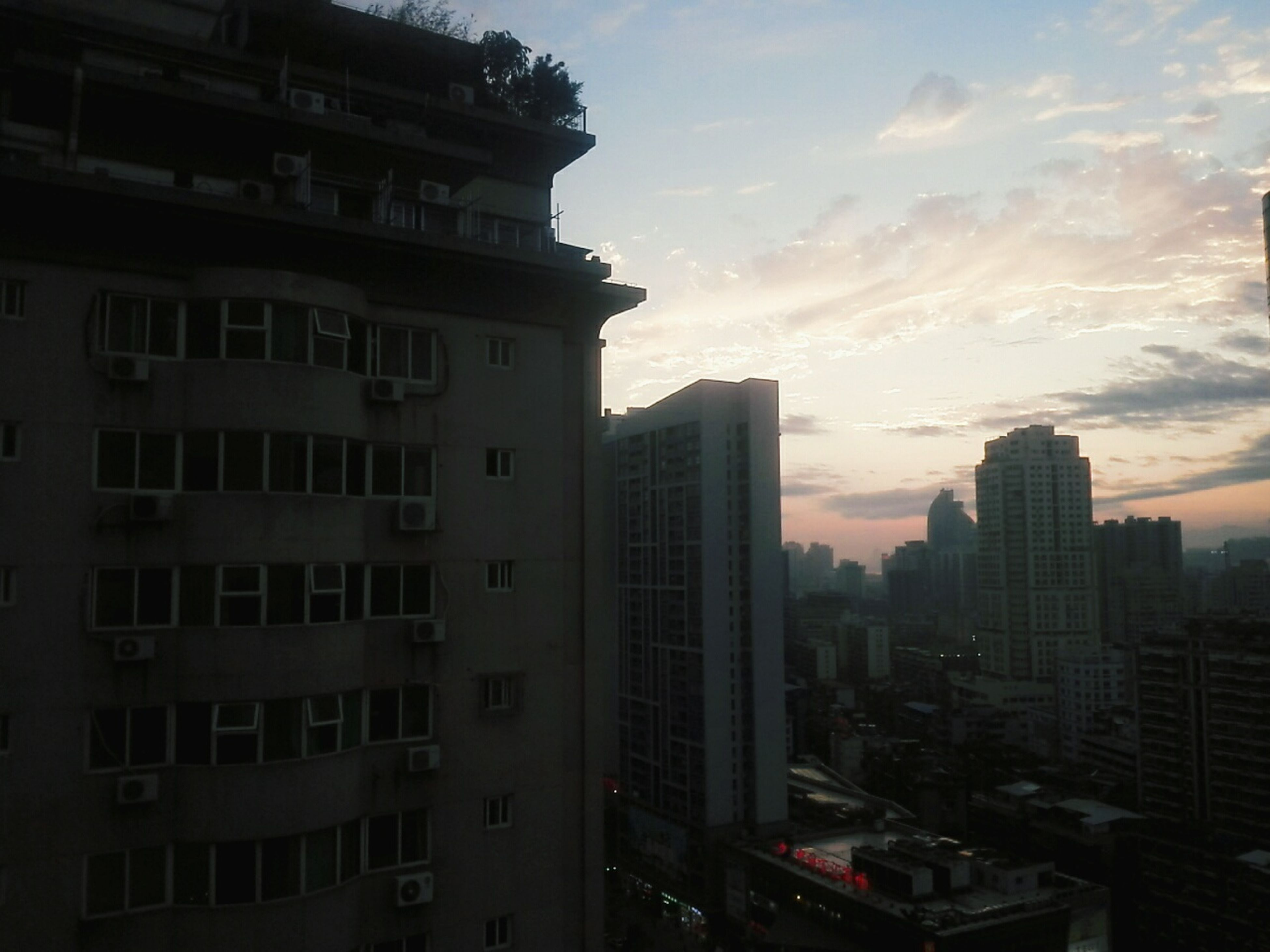 building exterior, architecture, built structure, city, skyscraper, sky, sunset, cityscape, building, office building, residential building, city life, tall - high, modern, cloud - sky, residential structure, tower, residential district, outdoors, no people