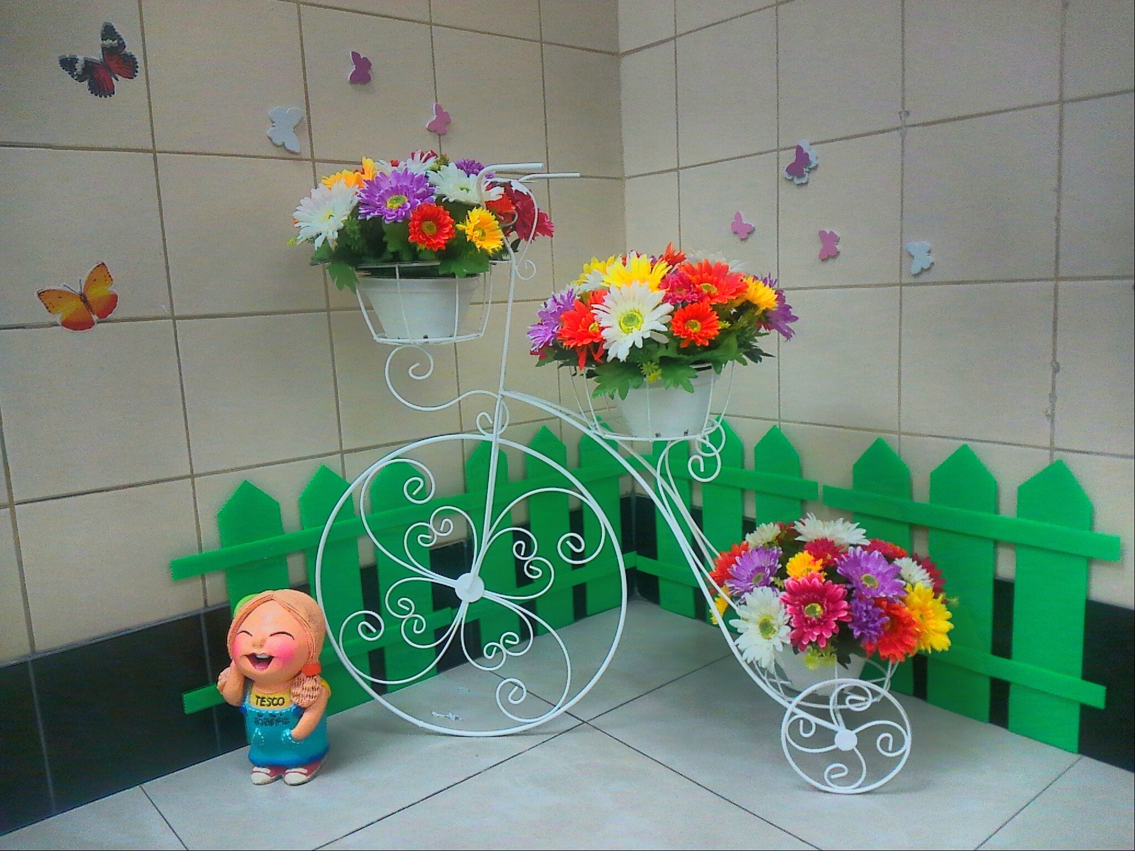 flower, indoors, multi colored, wall - building feature, freshness, fragility, tiled floor, petal, vase, flooring, high angle view, potted plant, pink color, plant, decoration, wall, childhood, tile, flower head, red
