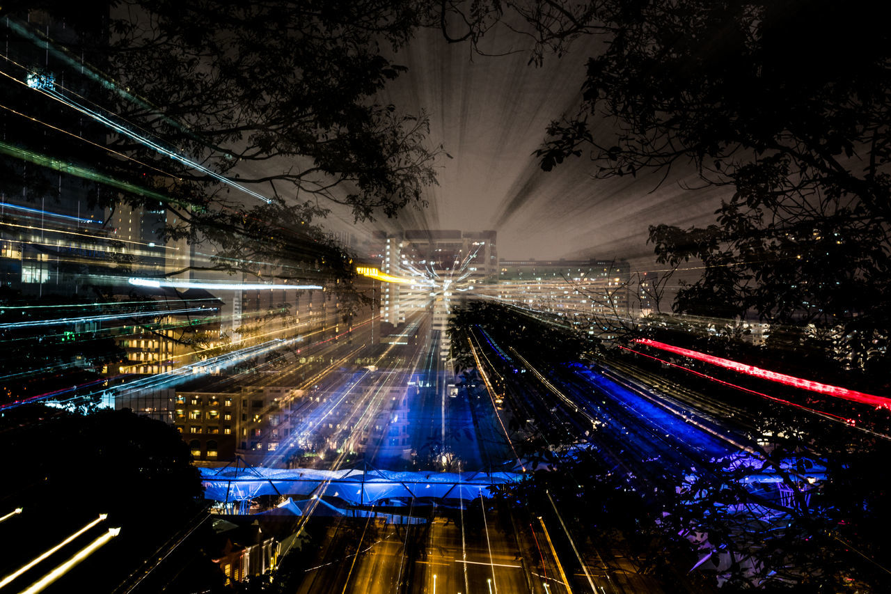 Zooming in the city Architecture City Citylights Experimental Eye4photography  High Angle View Illuminated Lazy Shutters Light Trail Lighttrails Long Exposure Night No People Outdoors Singapore Sky Something Different Speed Tree Zomming