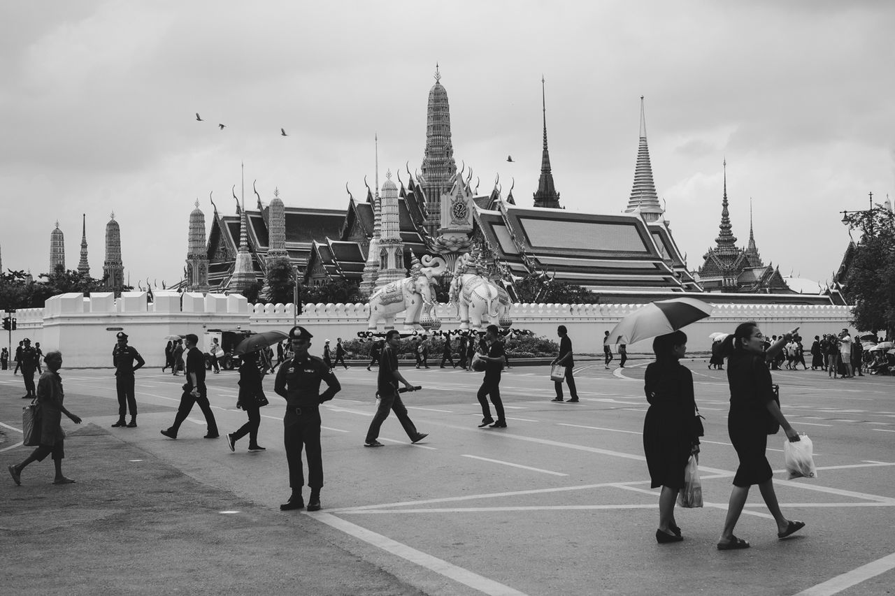 The Grand Palace. Bangkok. The mourning period for the death of the most loved king of Thailand on its 12th day. People all over Thailand, locals and foreigners alike, wear black shirts and dresses signifying their sympathy to the country and respect to the king who died dedicating his life to serve his people. ASIA Built Structure City Cultures Grand Palace Bangkok Thailand Large Group Of People Lifestyles Mourning People Real People Royalty Thailand Travel