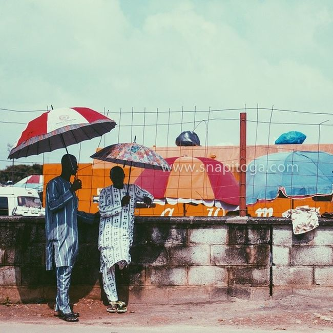 Sometimes it is good to just take a break from LagosHustle and open up your umbrella! Seen at Yaba bus stop. Vscocam Lagos Nigeria Africa Nigerian snapitoga everydayAfrica Yaba