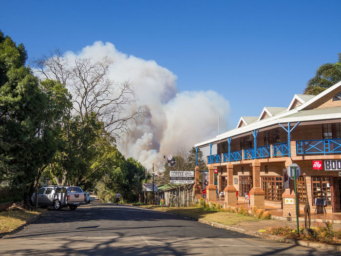 Architecture Building Exterior Built Structure Car Day Forest Fire No People Outdoors Road Sky Smoke - Physical Structure Street Sunlight Tree Sabie Sabie, Mpumalanga South Africa Smoke Forest Fires