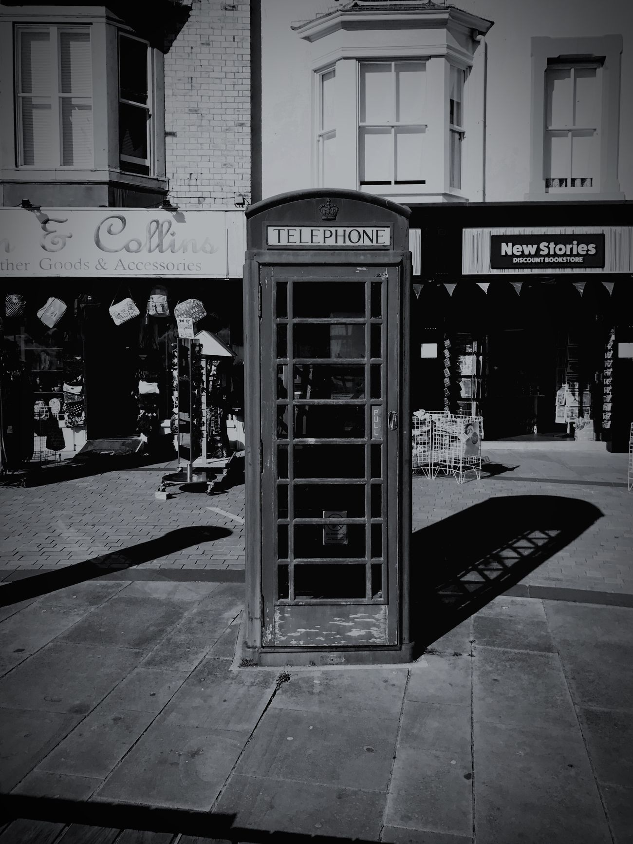 First Eyeem Photo Outdoors Communication Text Built Structure Building Exterior City Architecture No People Day Technology Close-up Blackandwhite Black White Dark Vintage Inspiration England Frontal Front View Frontal Shot Telephone Booth Telephone Old Welcome To Black