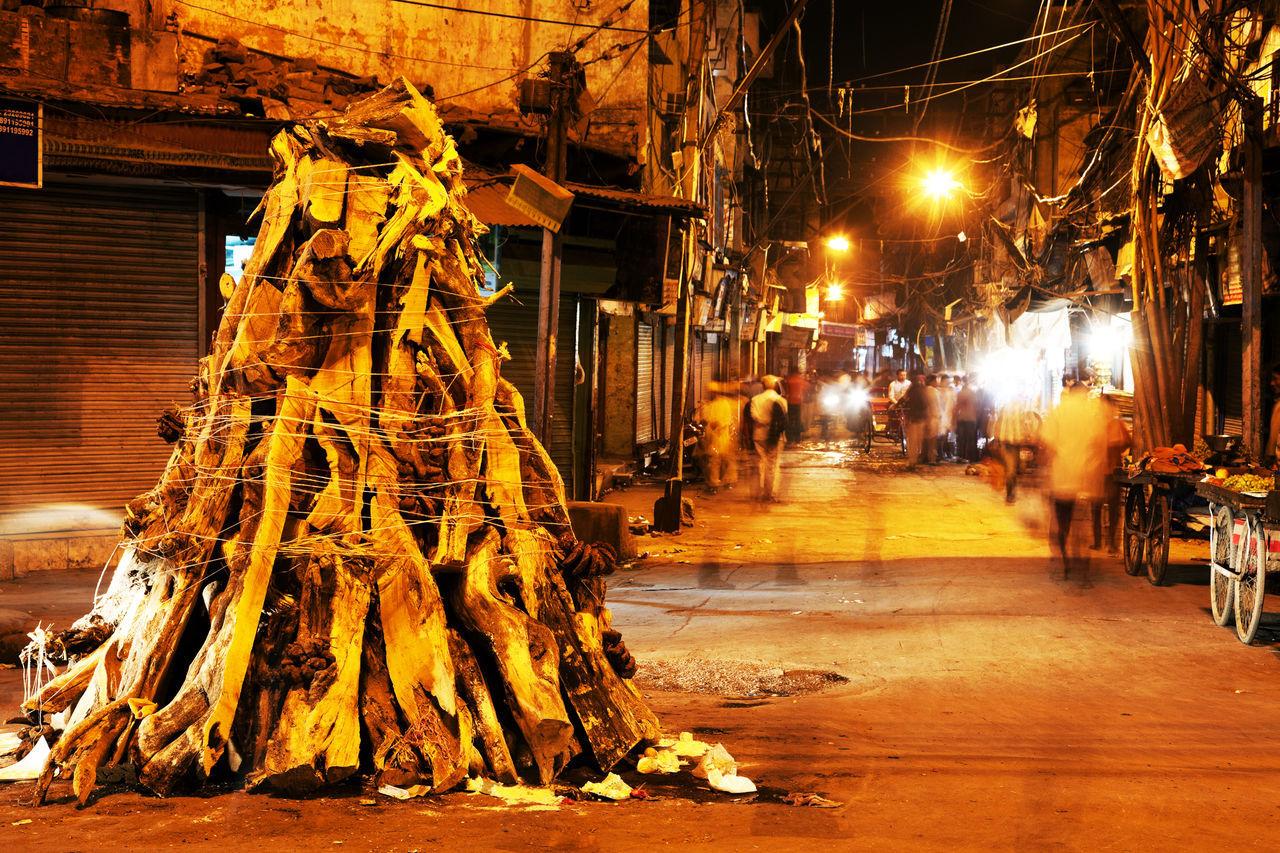 Firewood On Street In Illuminated City At Night