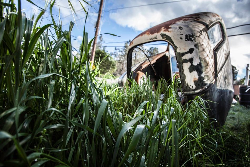 IMYE Loudthougts Takeawalkwithme Grass Growth Field Sky Nature Plant Agriculture Rural Scene Transportation Mode Of Transport Land Vehicle No People Abandoned Green Color Day Outdoors Scenics Landscape EyeEm Best Shots EyeEm Transportation Antique