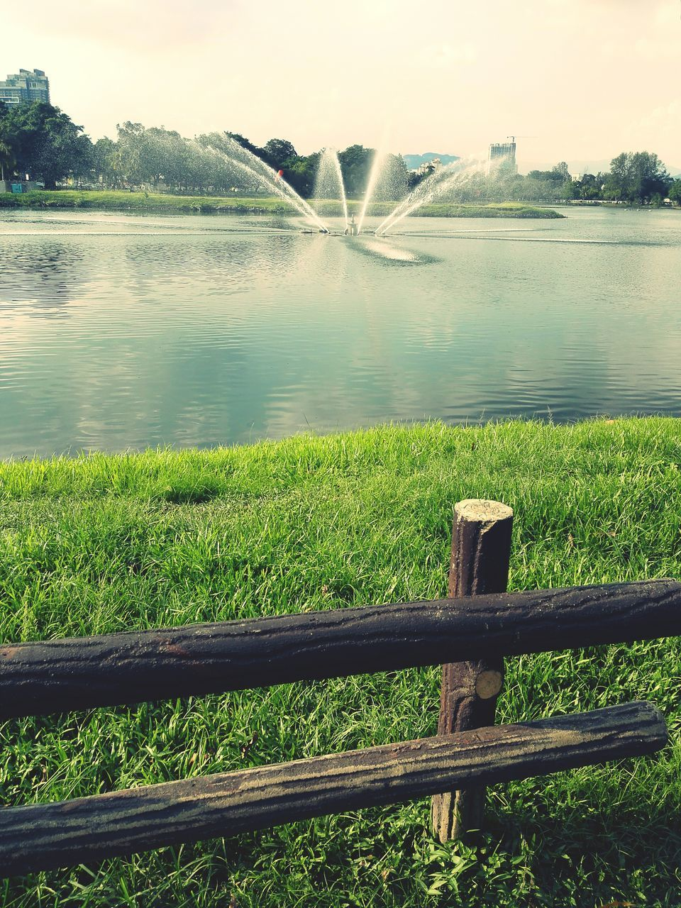 water, nature, outdoors, spraying, grass, beauty in nature, no people, green color, day, scenics, lake, motion, irrigation equipment, tree, sky